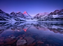 The crystal-clear Lake Magog in Mt Assiniboine Provincial Park British Colombia