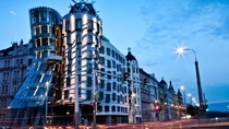 The Dancing House Pragues Nationale-Nederlanden building was designed by Croatian-Czech architect Vlado Miluni and Canadian-American architect Frank Gehry The deconstructionist architecture forms an unusual dancing shape thanks to  concrete panels each a