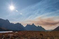 The darkness of a wildfire lingering over the Tombstones Yukon Canada