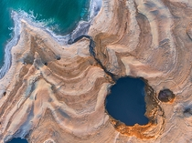 The Dead Sea is shrinking and as its waters vanish at a rate of more than one meter a year hundreds of sinkholes some the size of a basketball court some several storeys deep are devouring land where the shoreline once stood  Photo by Cristian Kirshbom