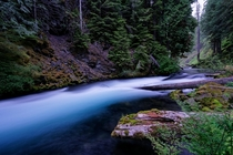 The deepest blue color Ive seen in a river McKenzie River Oregon at dusk