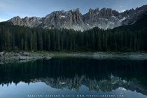 The Dolomites reflecting in Lake Carezza - South Tyrol Italy  by Stefano Baglioni