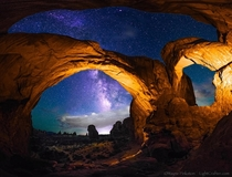 The Double Arch under the night sky Arches NP Utah  photo by Wayne Pinkston
