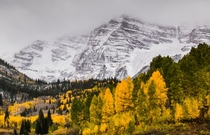 The dramatic Maroon Bells in Colorado during a fall snow dusting