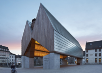 The dual-gabled timber and concrete structure Market hall in Ghent Belgium Designed by Belgian studios Robbrecht en Daem and Marie-Jos Van Hee