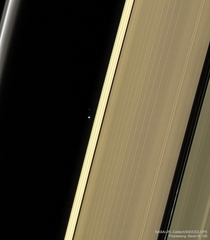 The Earth and our Moon imaged through Saturns Rings