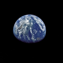 The Earth photographed by the Apollo  crewmen as they sped toward the fourth lunar landing