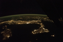 The easily recognized boot of Italy and the Balkans at night photographed from ISS