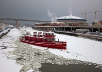 The Edward M Cotter oldest active fire boat in the world traveling up the icie Buffalo River