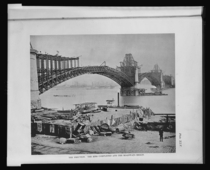 The erection of the Eads Bridge spanning the Mississippi St Louis Missouri the ribs completed and the roadways begun