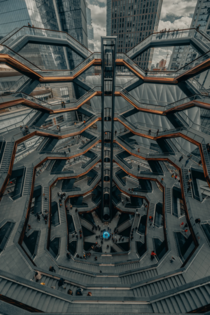 The extraordinary centerpiece of New Yorks Hudson Yards is its spiral staircase Comprised of  intricately interconnecting flights of stairs a soaring new landmark meant to be climbed This interactive artwork was imagined by Thomas Heatherwick and Heatherw