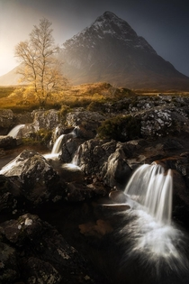 The famous Etive Mor waterfall with beautiful fall colors