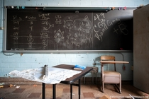 The final lesson remains on the chalkboard in an abandoned classroom