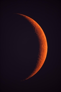 The fires in northern California are so bad that we all were sent home from work yesterday Those same unhealthy particles in the air are causing light from the sunmoon to scatter way more than normal turning them red Here is the moon last night color uned