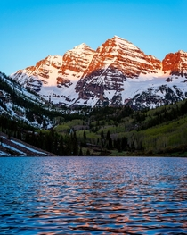 The first light of day strikes the Maroon Bells near Aspen CO