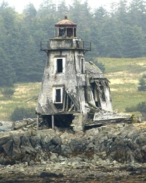 The foundation crumbles beneath the Grand Harbor Lighthouse on Fish Fluke Point Ross Island Canada