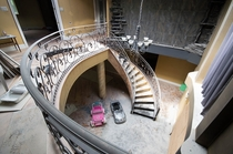 The foyer and grand spiral staircase in an abandoned mansion OC -