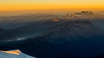 The French Alps basking in the glow of a golden sunrise