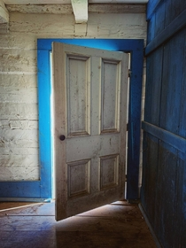 The front door of an old settlers log cabin in Ontario Canada