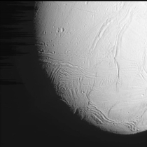 The frozen surface of Saturns moon Enceladus