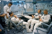 The Gemini  prime and backup crew relaxing at the Gemini Mission Simulator in  From left to right William Anders Richard Gordon Charles Conrad and Neil Armstrong