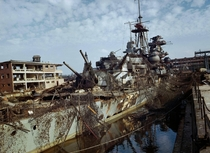 The German cruiser Admiral Hipper sits abandoned in a dry dock at Kiel after being damaged by RAF raids