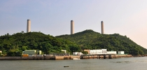 The giant chimneys of Lamma Power Station towering over idyllic Lamma Island Hong Kong