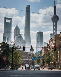 The giants of Pudong district seen from the streets of Shanghai China