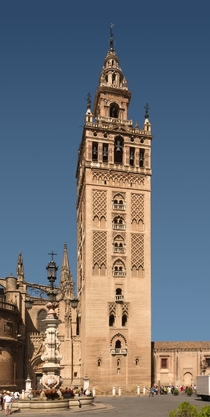 The Giralda built as the minaret for the Great Mosque of Seville it became the bell tower of the Seville Cathedral after the reconquest of the city by the catholics