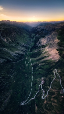The Glowing Rift - The very last lights of the day in this aerial vertical panorama over the Valle des Villards road French Alps
