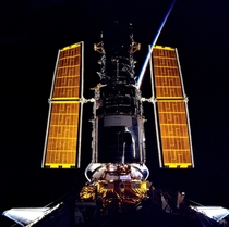 The gold of the solar arrays illuminated from behind by the sunrise provides stark contrast to the blackness of space in this scene photographed at the completion of the servicing of the Hubble Space Telescope in Dec  This photo was taken from NASAs Space