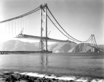 The Golden Gate Bridge nearing completion in
