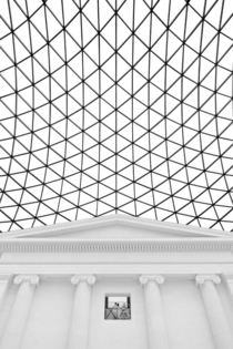 The Great Court of the The British Museum by Foster and Partners  at its connection point to the original South Entrance by Sir Robert Smirke