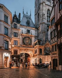 The Gros Horloge a th century astronomical clock installed in a Renaissance arch crossing a street in Rouen Normandy France