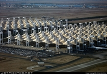 The Hajj Terminal at King Abdul Aziz International Airport in Jeddah Saudi Arabia Designed as desert tents that houses pilgrims coming for the annual pilgrimage to Mecca