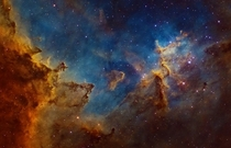The Heart Nebula is a vast region of glowing gas energized by a cluster of young stars at its centre The image depicts the central region where dust clouds are being eroded and moulded into rugged shapes by the searing cosmic radiation