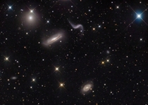 The Hickson  galaxy cluster