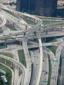 The High Five Interchange in Dallas is  levels- US  on the Bottom Level Frontage Roads on the Second the LBJ freeway I- on the Third and flyover ramps on the Fourth and Fifth