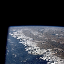 the Himalaya mountains as seen from the Apollo  spacecraft Mount everest can be seen in the lower center of the picture Photo by NASA