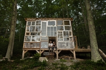 The homes most stunning feature an entire wall of windows salvaged from abandoned houses and estate sales around the country