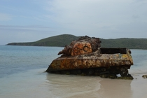 The hulk of a US Army tank rests forgotten on a Caribbean Island