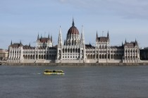 The Hungarian Parliament  A symmetrical facade and central dome Dome is Renaissance Revival Its interior includes  courtyards  elevators  gates  staircases and  rooms