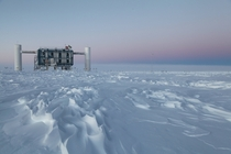 The IceCube Lab in the setting sun at the Amundsen-Scott South Pole Station in Antarctica