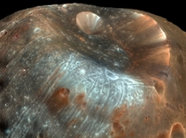 The image of the stickney crater the largest crater on the Martian moon Phobosis named for mathematician Chole Angeline Stickney Over  km across it is nearly half the diameter of Phobos itself