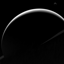 The image was captured by Cassini as it was flying about  million miles  million kilometers from the ringed wonder Some of Saturns ring plane can even be seen in the black and white image