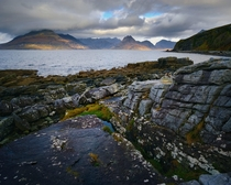 The incredulous coast around Elgol watching the light dance across the Black Cuillins Isle of Skye Scotland UK
