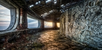 The inside of the Buzludzha monument at sunset Potok Gabrovo Bulgaria   By Don Komarechka