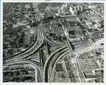 The Interchange of I- and MI- in Detroit was the first full freeway to freeway interchange in the United States opening in  Its unique for using left hand exit and entrance ramps for left turns