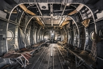 The interior of an abandoned aircraft  By Marco
