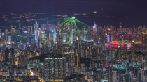 The International Financial Centre and other skyscrapers shooting green laser beams in Hong Kong